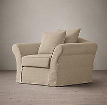 Camelback Slipcovered Swivel Chair