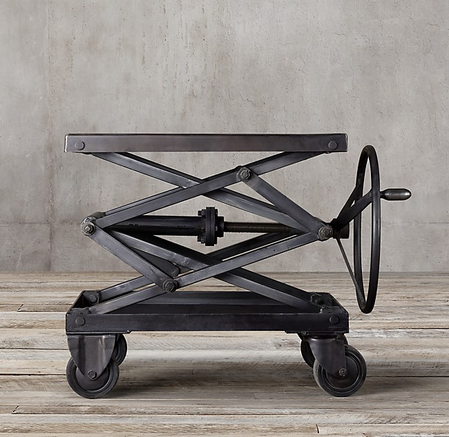 The Industrial Scissor Lift Table is a reproduced 20th-century