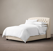 Warner Tufted Fabric Bed With Nailheads